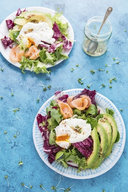 Mixed leaf salad with avocado, poached egg and smoked salmon