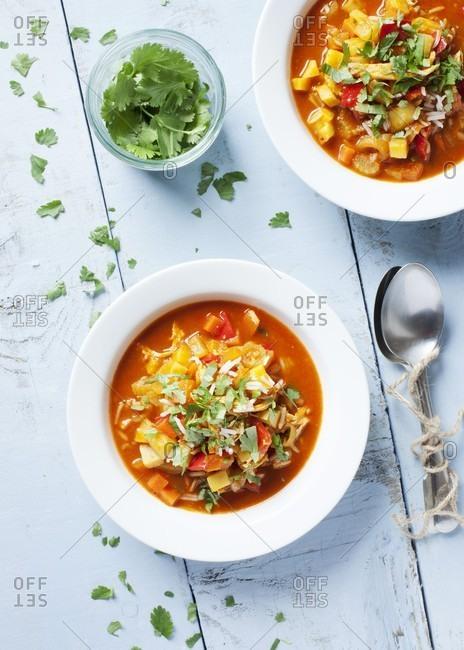 Mulligatawny soup, garnished with fresh coriander