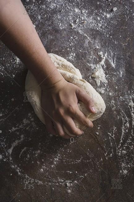 Kneading pizza dough