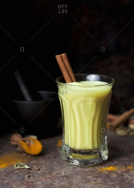Golden milk: milk drink with turmeric, cardamom and cinnamon