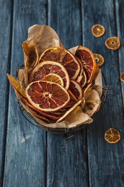 Dried orange slices in a wire basket