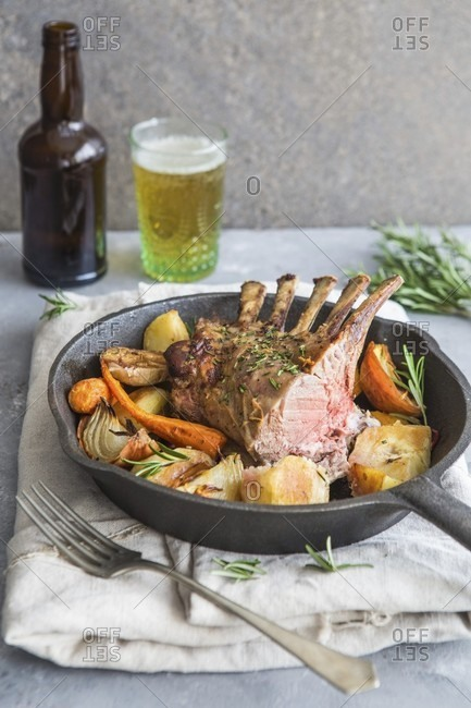 Saddle of lamb with roasted vegetables served with a beer