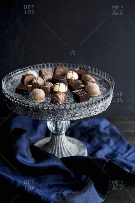 Various pralines on a vintage cake stand