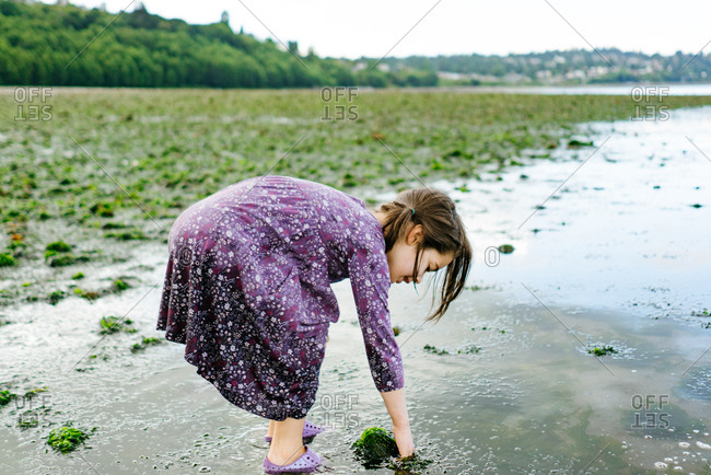 Girl exploring a beach in Seattle, Washington