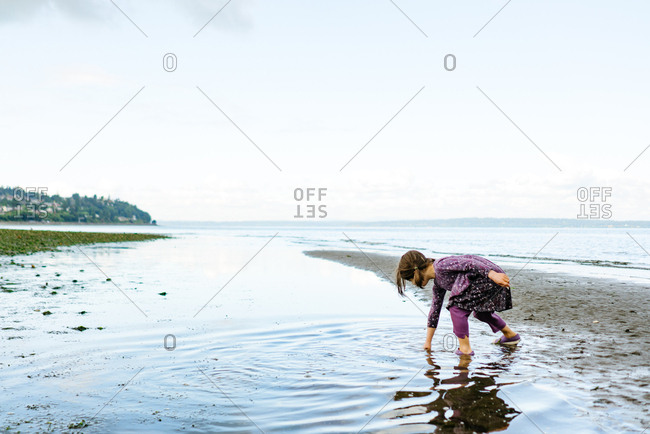 Girl exploring a beach in Carkeek Park, Seattle, Washington