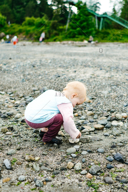 Baby exploring rocky beach in Seattle, Washington