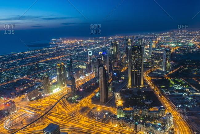 April 26, 2014: View over Dubai from Burj Khalifa at night, Dubai, United Arab Emirates, Middle East