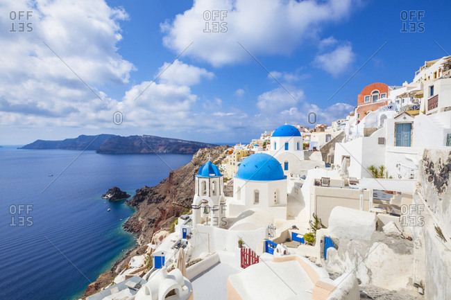 Greek church with three blue domes in the village of Oia, Santorini (Thira), Cyclades Islands, Greek Islands, Greece, Europe