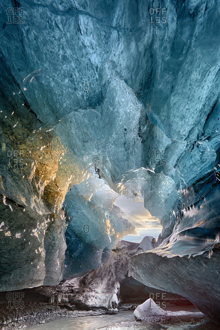 View inside an ice cave under the south Vatnajokull Glacier, captured at sunrise during winter when the ice caves are accessible, near Jokulsarlon, Southern Iceland, Iceland, Polar Regions
