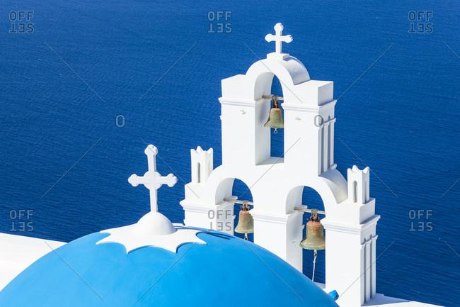 Blue dome and bell tower, St. Gerasimos church, Firostefani, Fira, Santorini (Thira), Cyclades Islands, Greek Islands, Greece, Europe