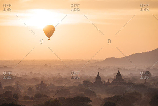 View of hot air balloon and temples at dawn, Bagan (Pagan), Mandalay Region, Myanmar (Burma), Asia