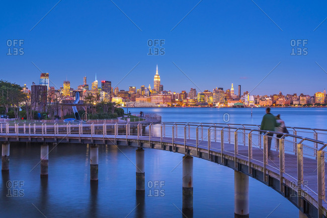 October 16, 2015: Manhattan, Lower Manhattan and World Trade Center, Freedom Tower in New York across Hudson River from Pier C Park, Hoboken, New Jersey, United States of America, North America