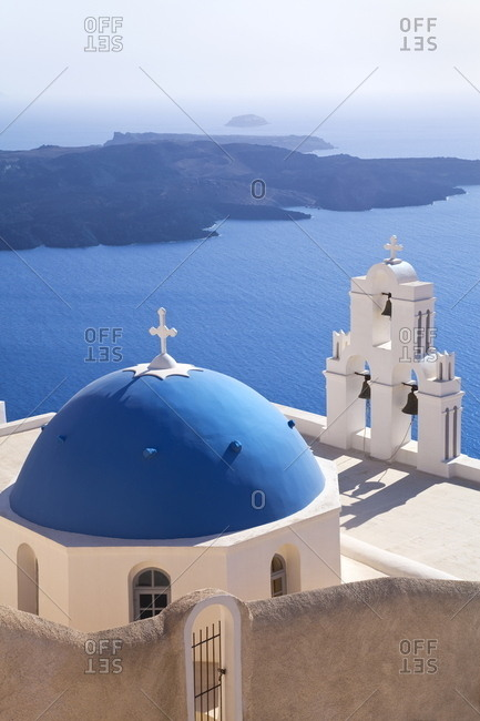 Bell Tower of Orthodox Church overlooking the Caldera in Fira, Santorini (Thira), Cyclades Islands, Aegean Sea, Greek Islands, Greece, Europe