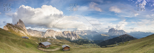 Panorama of green meadows and huts of the Odle mountain range seen from Seceda, Val Gardena, Trentino-Alto Adige, Italy, Europe