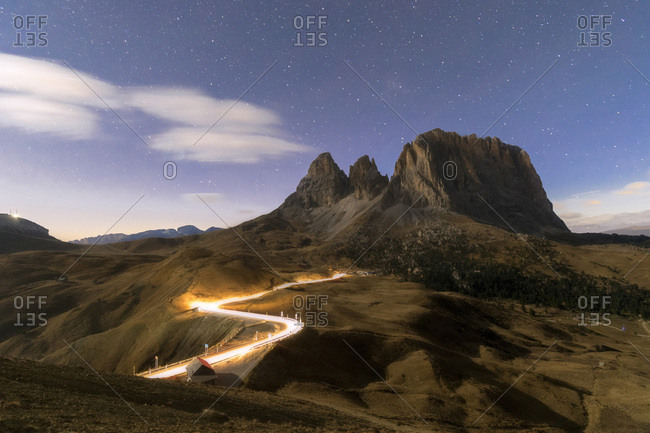 Lights of car trails with Sassopiatto in the background, Dolomites, South Tyrol, Italy, Europe