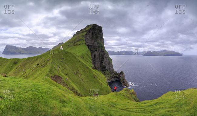 Panoramic of Kallur Lighthouse on cliffs, Kalsoy Island, Faroe Islands, Denmark, Europe