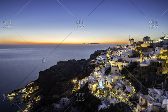 Long exposure sunset view over the whitewashed buildings and windmills of Oia, Santorini, Cyclades, Greek Islands, Greece, Europe