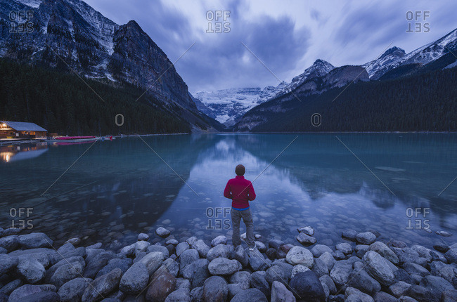 Lone traveler at Lake Louise in the morning, Banff National Park, UNESCO World Heritage Site, Canadian Rockies, Alberta, Canada, North America