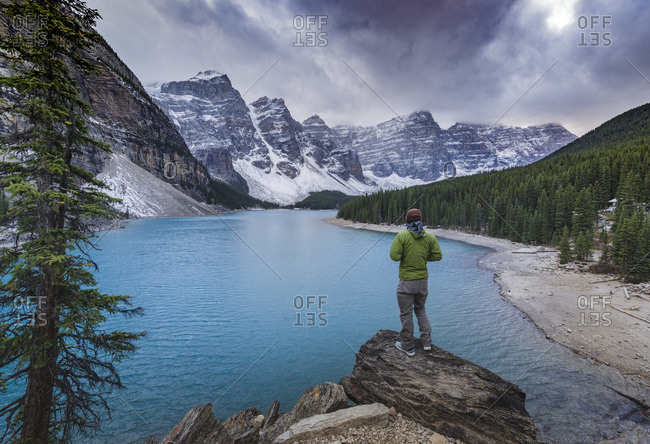 Tourist watching the scenery of the Moraine Lake, Banff National Park, UNESCO World Heritage Site, Canadian Rockies, Alberta, Canada, North America