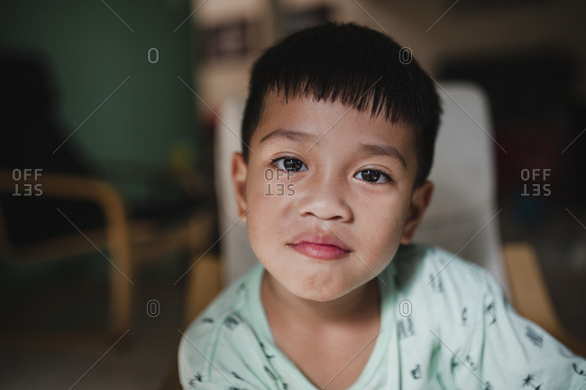 Portrait of a Southeast Asian boy at home