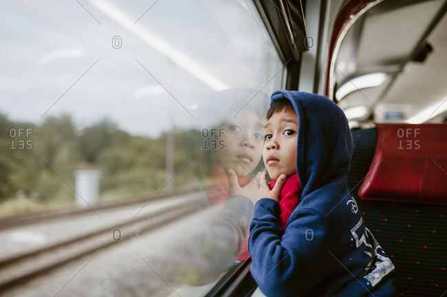 Boy watching the scenery out of train window