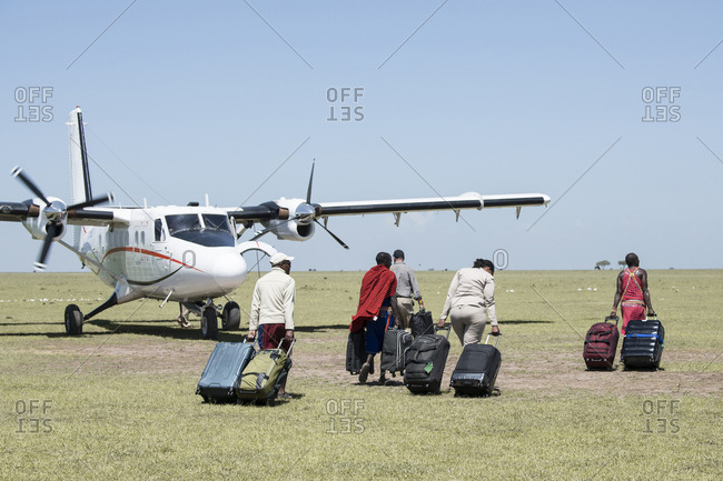 Maasai Mara, Kenya, January 28, 2018: People walking towards airplane at Kenyan Airport