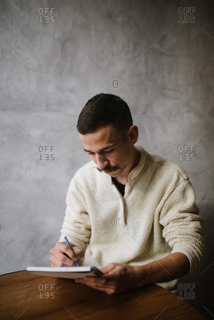 Young designer sketching in the sketchbook