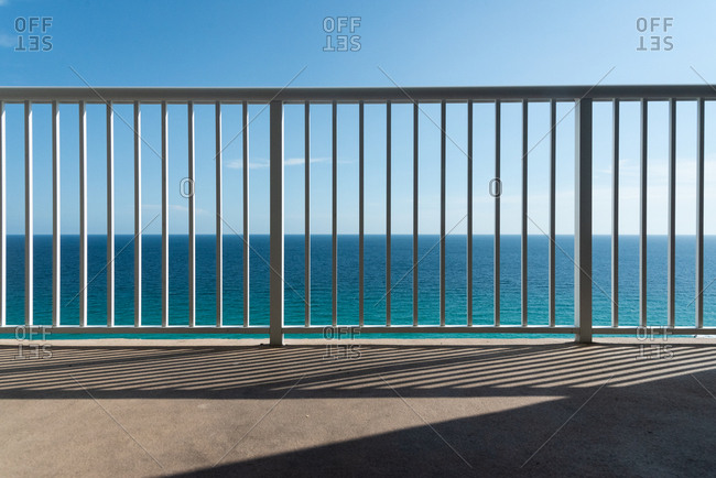 View of ocean and blue sky from hotel balcony