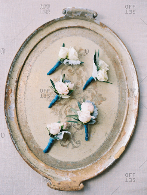 Boutonnieres on a vintage tray