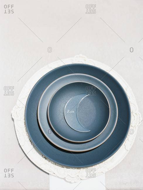 Overhead view of plates with moon nametag