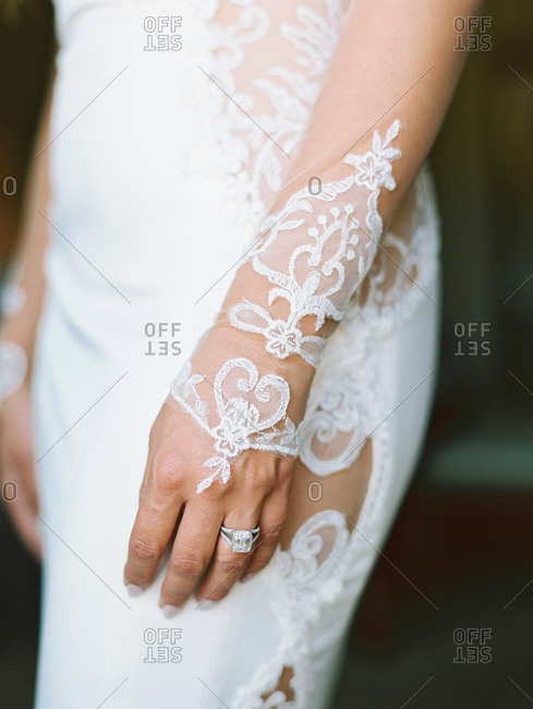 Close up of bride's lace detail on dress