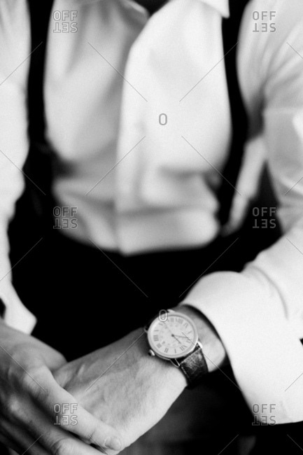 Detail of groom's watch in black and white