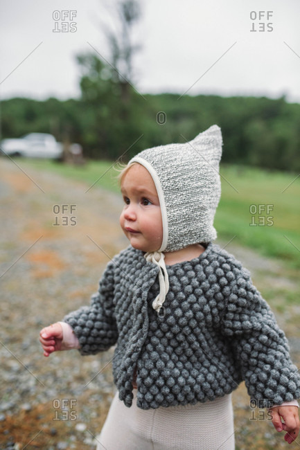 Close up of baby girl on a dirt road