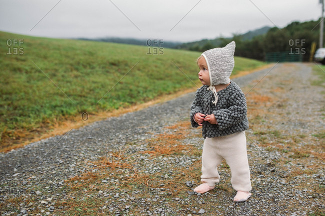 Baby girl on a dirt road