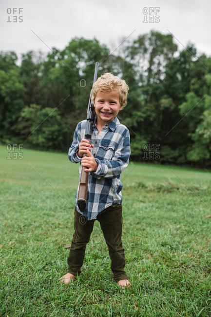 Young boy holding gun