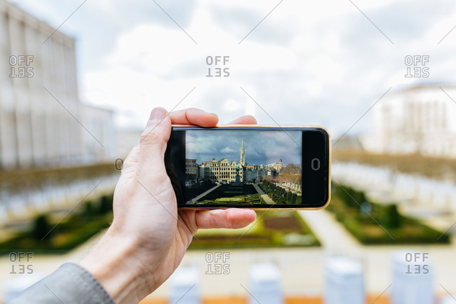Close-up of man taking a photograph with Smartphone in Mont des Arts, Brussels, Belgium
