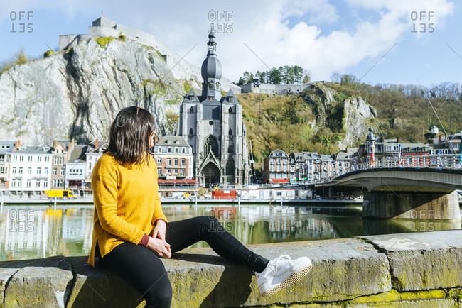 Woman looking towards Dinant village in Belgium