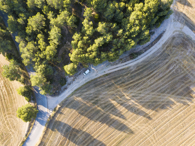 Small rural road through fields of cultivation in the province of Barcelona in Catalonia Spain Europe