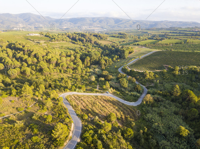 Small rural hilly road through fields of cultivation in the province of Barcelona in Catalonia Spain Europe