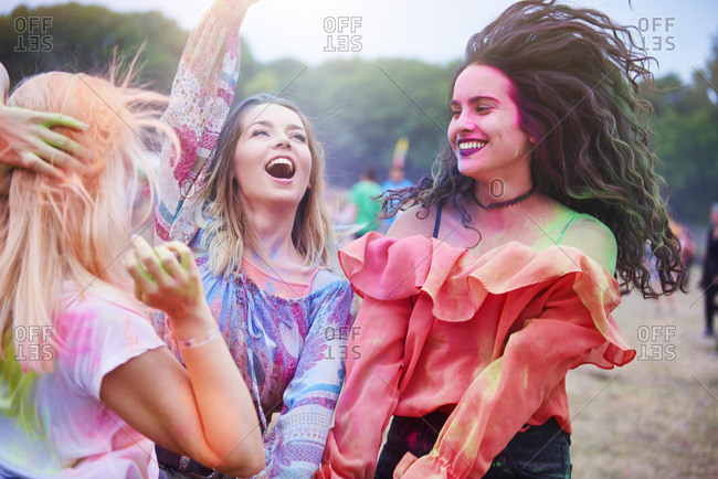 Happy women dancing at the music festival