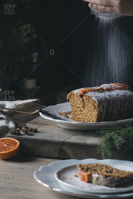 Woman preparing home-baked Christmas cake