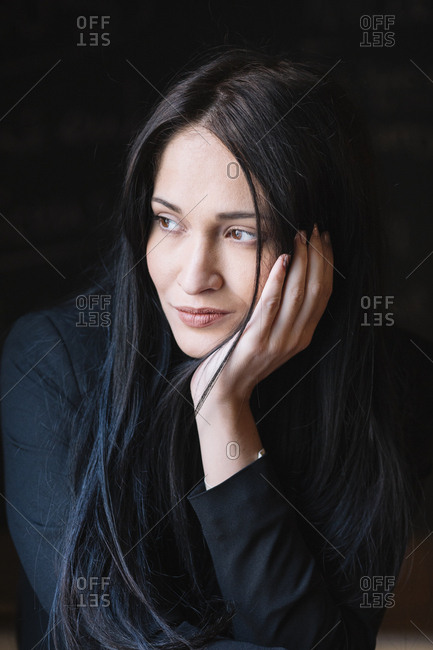 Portrait of thoughtful long-haired young woman