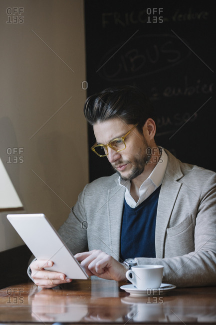 Businessman using tablet in a cafe