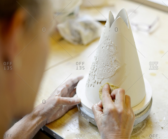 Close-up of woman working in porcelain workshop
