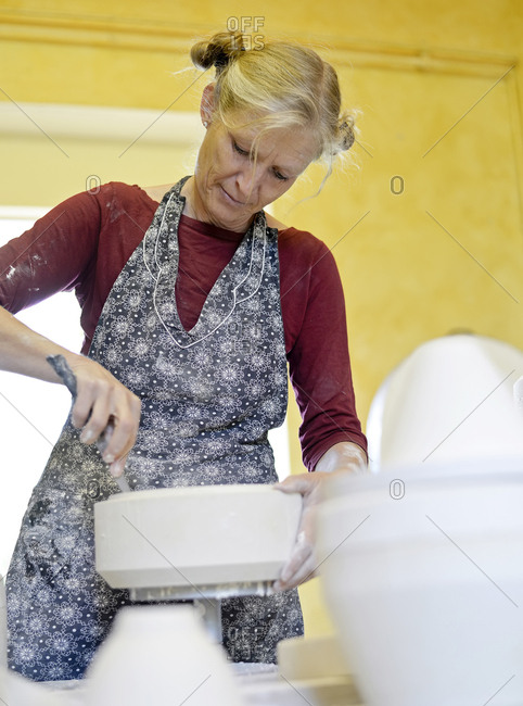 Woman working in porcelain workshop