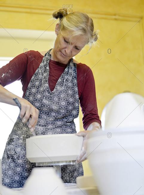 Woman working in porcelain workshop