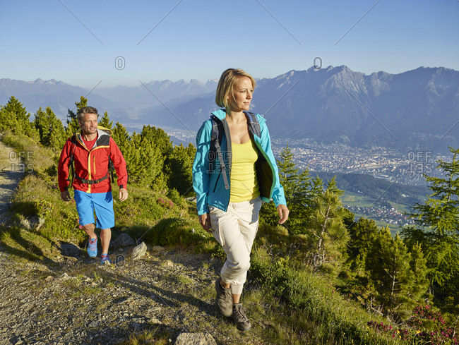 Austria, Tyrol, Couple hiking the Zirbenweg at the Patscherkofel