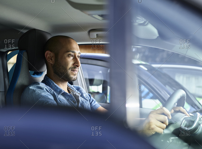 Young man driving electric car