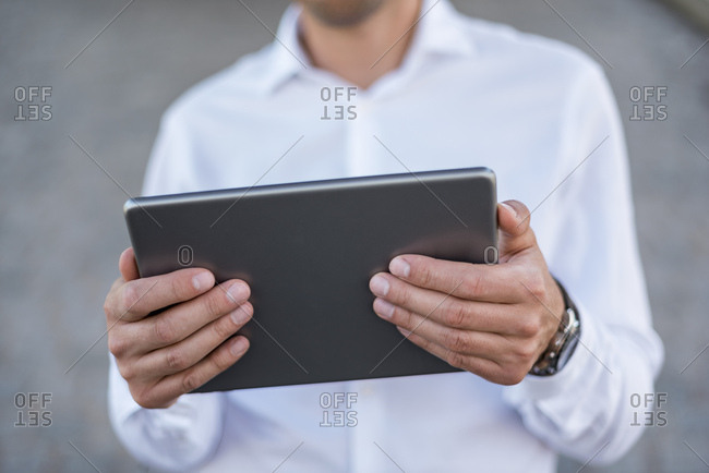 Close-up of businessman holding tablet