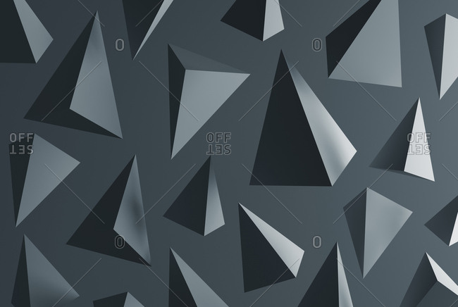 Grey pyramids in front of grey background